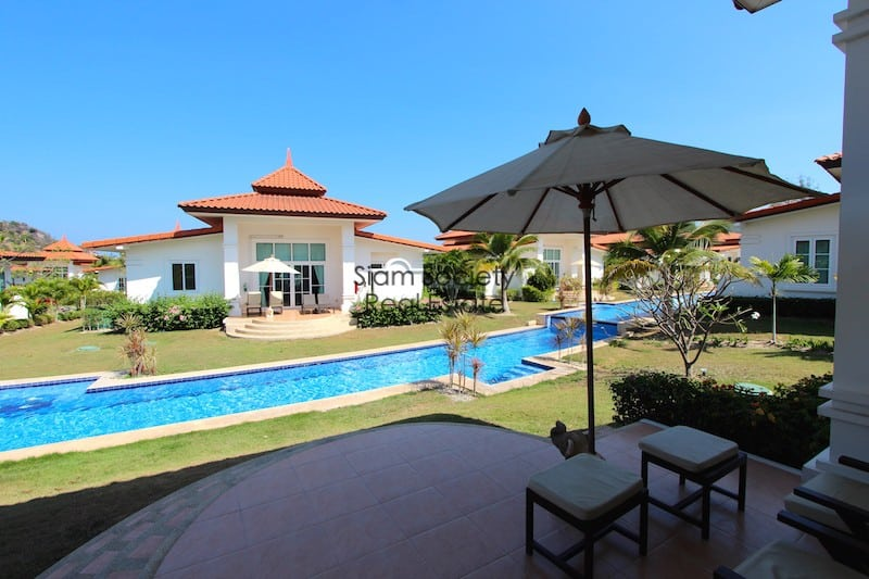 Terrace overlooking canal pool at Banyan CD Villas