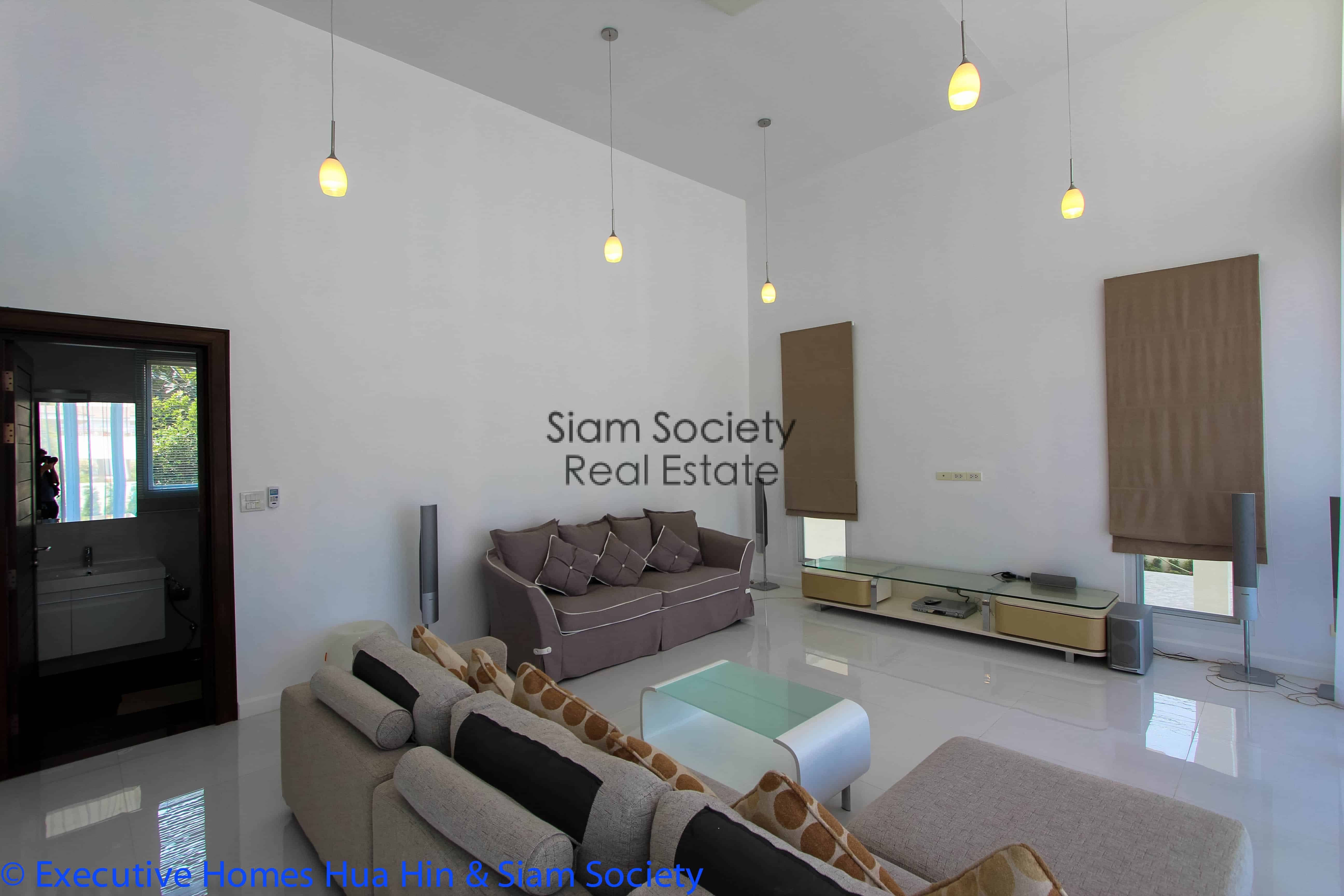 Open plan living space in modern beach house for sale in central hua hin